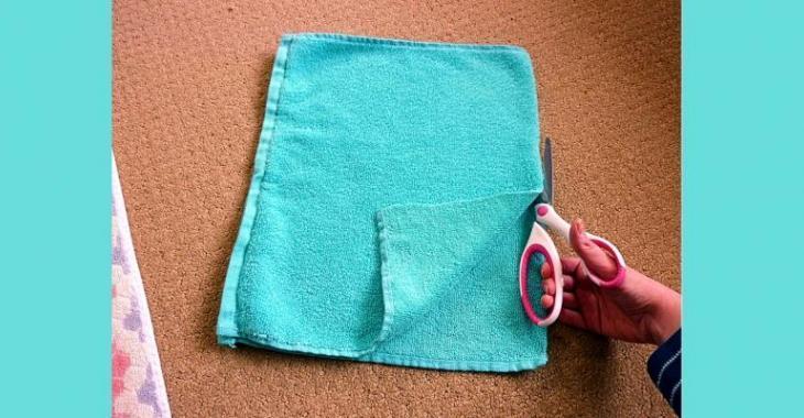Elle coupe une ancienne serviette de bain! Le résultat? Je dois ...